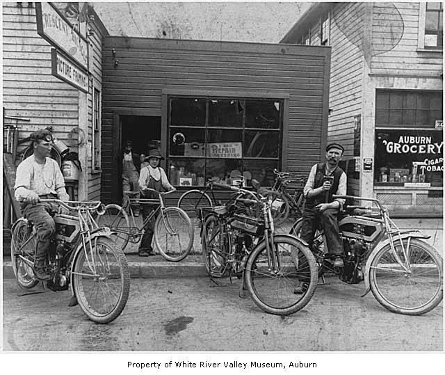 Shop 1912 showing a excelsior and another antique motorcycle (photo