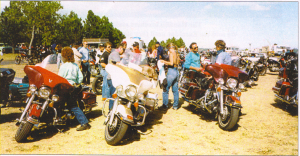 Sturgis 1987. Connie, Sam and me on my white and tan FLHTC, somewhere in the hills.