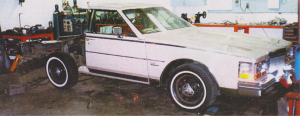 We built this custom Cadillac in 1983. WE took a beautiful four door, cut it in tow, cut the top off, etc.  My sons Rick and Russ did all the work.  Rick painted it white. I had a new black top and R&R grill installed by Durham's in Seattle.