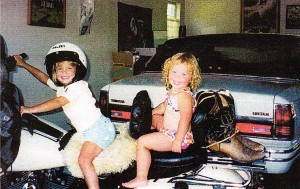 Chickee and Emily on my Harley. I had just returned from my yearly trip to Sturgis, S.D. My boots are still tied to my motorcycle.