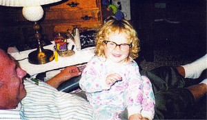 Emily sitting on my lap.  She loved to take my glasses offas you can see.  the girls used to walk to our house often as they lived only a block and a half away.  They now live twenty-five miles away.  We miss seeing them everyday!