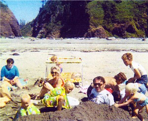 July 1970.  Russ and other kids bury Papa in the hot sand at Long Beach.