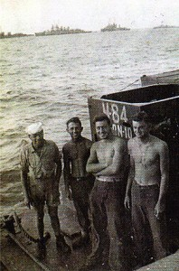 My crew: Ingles from new Hampshire, Charlie Burgess form Virginia, J.D. Davis from Mississippi and me, somewhere in the South Pacific in 1944.