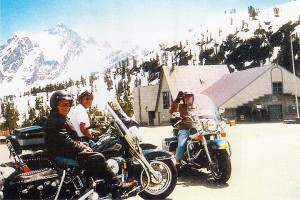 Ron, Al, myself (missing Slimbo).  A beautiful sunny day in 2002.  We rode up to Mt. Baker, Wash. As you can see, there was till lots of snow in the month of May. We could ride in T-Shirts.  We have riden together for years all over the Northwest.